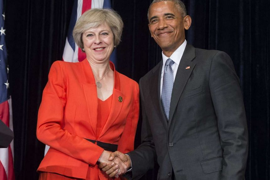 United States President Barack Obama and British Prime Minister Theresa May shaking hands following a press conference on the sidelines of the Group of 20 summit in Hangzhou on Sept 4, 2016.