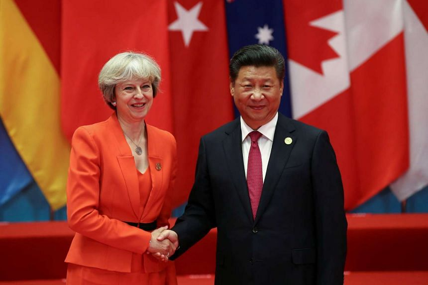 Chinese President Xi Jinping shakes hands with Britain's Prime Minister Theresa May during the G20 Summit in Hangzhou.