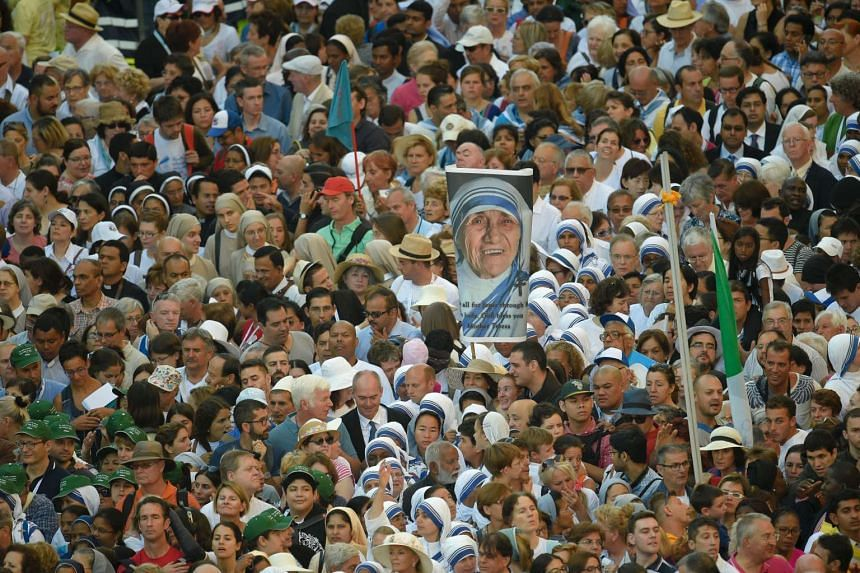 The faithful waiting for the holy mass and Canonisation of Mother Teresa of Kolkata, on St. Peter's square in the Vatican, on Sept 4, 2016. Mother Teresa, the celebrated nun whose work with the poor of Kolkata made her an instantly recognisable globa