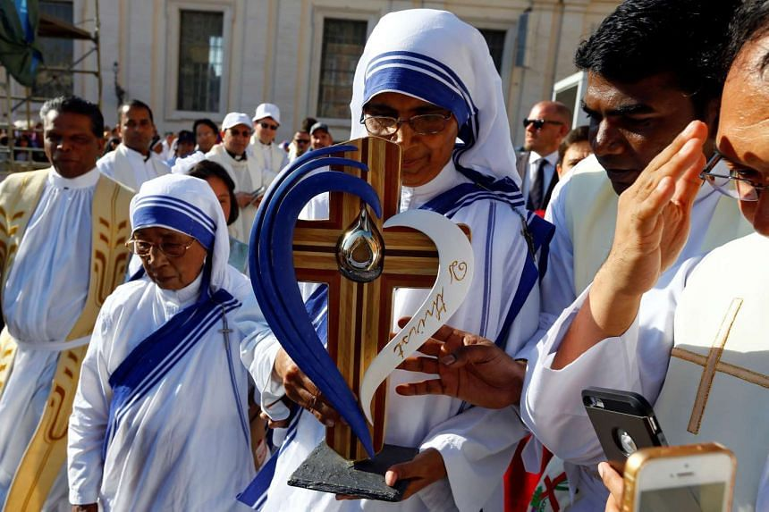 A nun belonging to the global Missionaries of Charity carrying a relic of Mother Teresa of Calcutta before a mass celebrated by Pope Francis for her canonisation in Saint Peter's Square at the Vatican on Sept 4, 2016.
