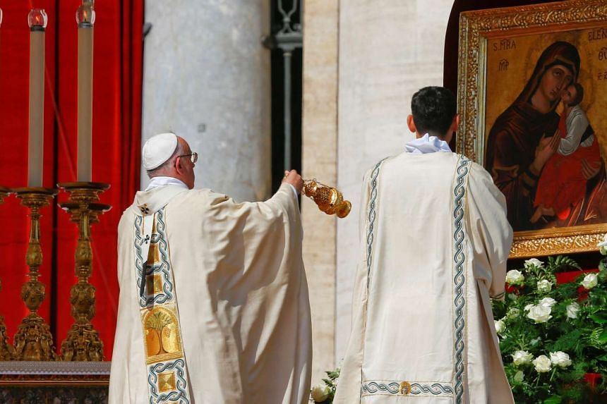 Pope Francis blesses with an incense burner as he leads a mass for the canonisation of Mother Teresa of Calcutta in Saint Peter's Square at the Vatican on Sept 4, 2016.