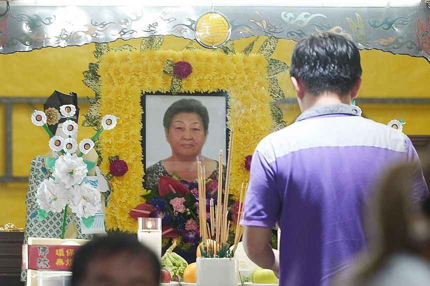 Madam Ong Lim was struck on the head by a road sign believed to have been dislodged by a runaway bus. She later died in hospital.