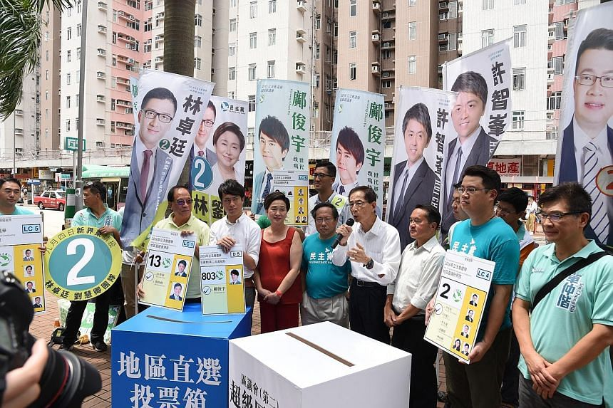 Five generations of Democratic Party chairmen, including (from left) Mr Yeung Sum (in yellow shirt), Ms Emily Lau (in red), Mr Albert Ho, Mr Martin Lee and Mr Lee Wing Tat, turned up to support the party's young contenders on the eve of polling day.