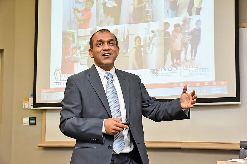 Prof Sumit (left) conducting a masterclass at NUS Business School last year, and with his younger sister and parents (right) in Uganda in 1992. The family moved to Africa when his father was working there as an economist with the World Bank.