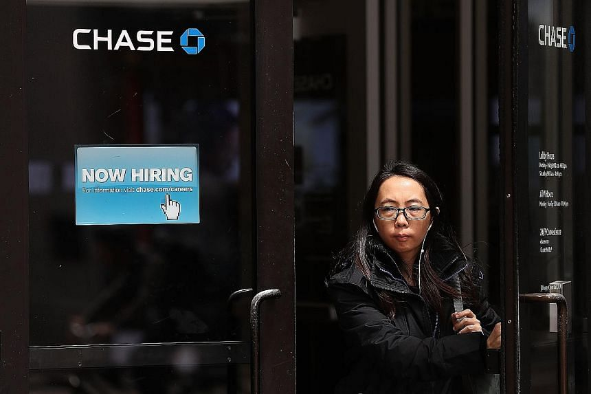 A recruitment sign outside a bank office in San Francisco, California. Despite robust US jobs numbers, the subdued inflation outlook and weakness in manufacturing and mining employment suggest that the Federal Reserve is likely to stay cautious in it