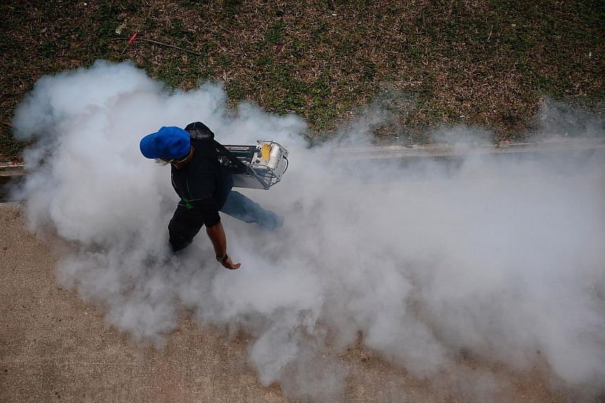 Fogging near Block 409 in Bedok North Avenue 2 on Thursday. The Zika virus can cause microcephaly in babies whose mothers were infected during pregnancy. Four out of five infected people do not show any symptoms.