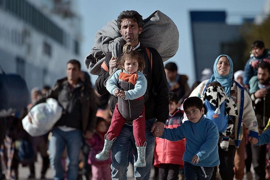 Refugees in the Greek port of Piraeus in February. Fears of terrorism have left Muslim refugees toxic in the West, and almost no one wants them any more than anyone wanted a German-Dutch girl named Anne Frank during the Nazi persecution.