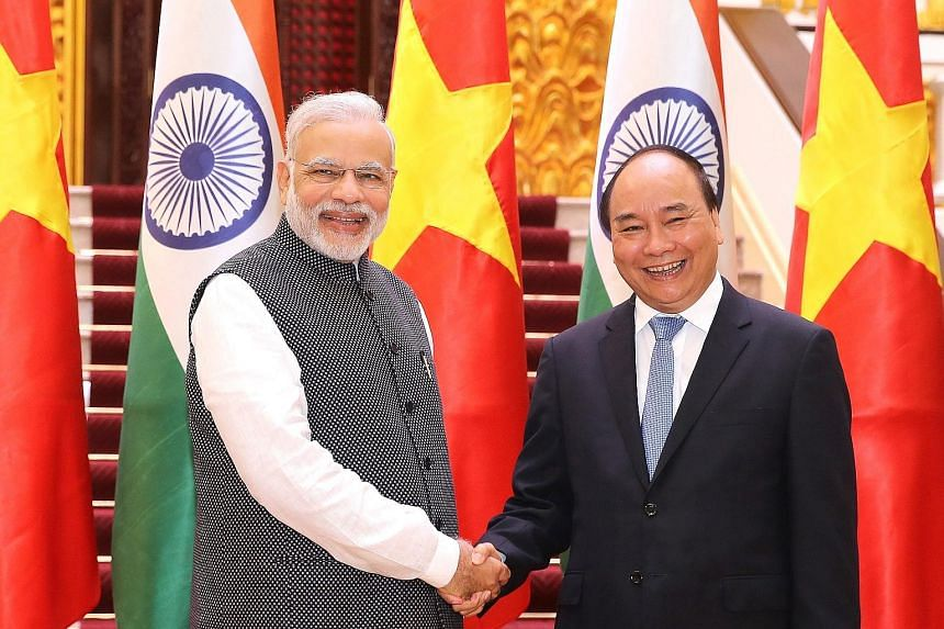 """Mr Modi and Mr Phuc meeting in Hanoi yesterday. Mr Modi, who was making the first visit to Vietnam by an Indian prime minister in 15 years, said the credit was for """"facilitating mutual defence cooperation""""."""