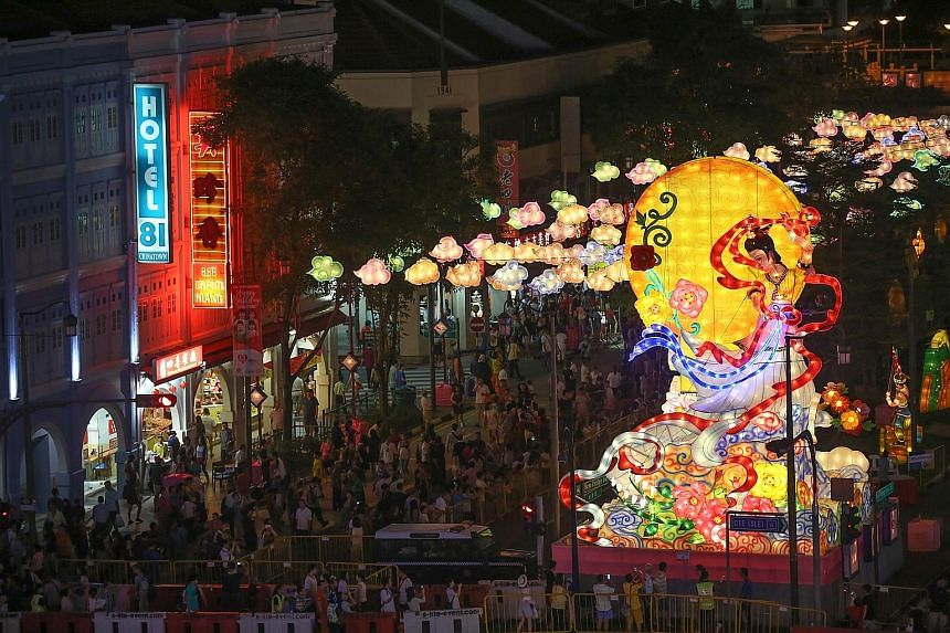 The streets of Chinatown turned into a dazzling display of lights last night as 900 lanterns were lit to mark the start of the month-long Mid-Autumn Festival celebrations. This year's centrepiece is a 12m-tall sculptured lantern featuring mythical mo