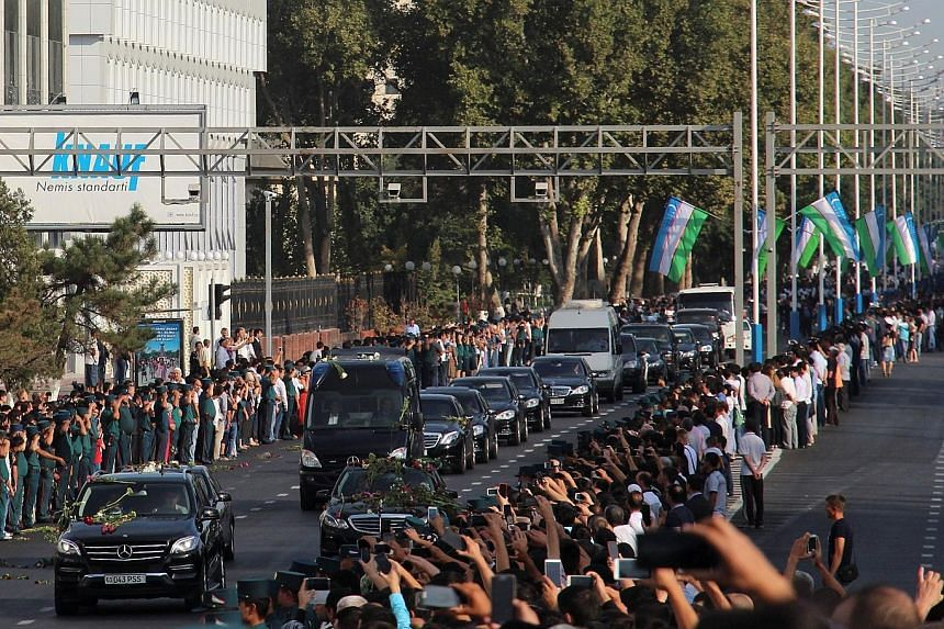 Uzbek President Islam Karimov (above) was pronounced dead late on Friday. Yesterday, crowds lined the roads as the cortege drove through Tashkent (right). He was buried in a cemetery in Samarkand.
