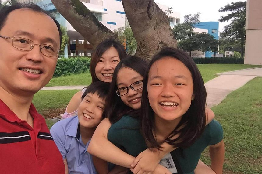Mr Loo Cheng Chuan with his wife Lee Bee Yee and three children Kate, Ben and Emily.