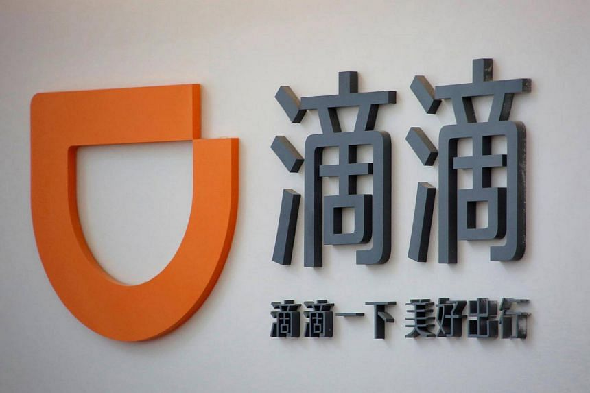 The logo of Didi Chuxing is seen at its headquarters in Beijing on May 18.