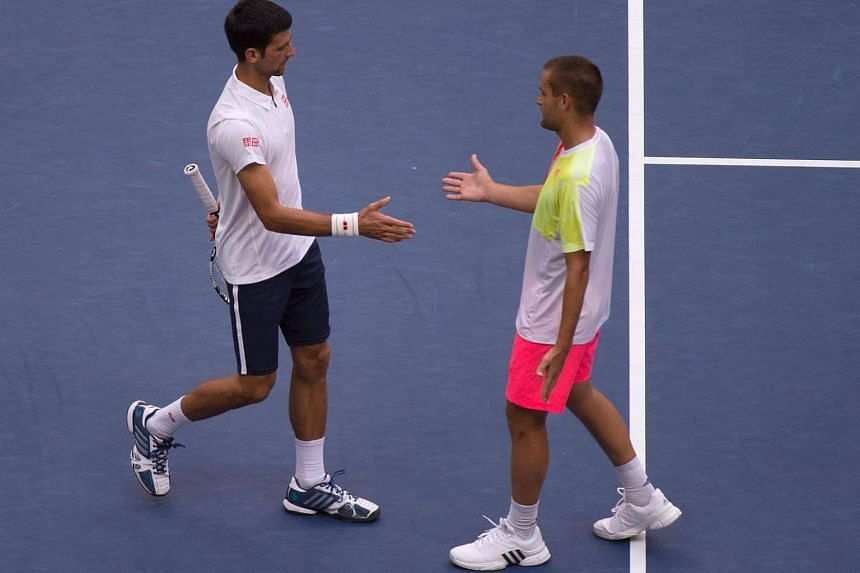 Novak Djokovic (left)and Mikhail Youzhny shake hands after their 2016 US Open men's singles match on Sept 2.
