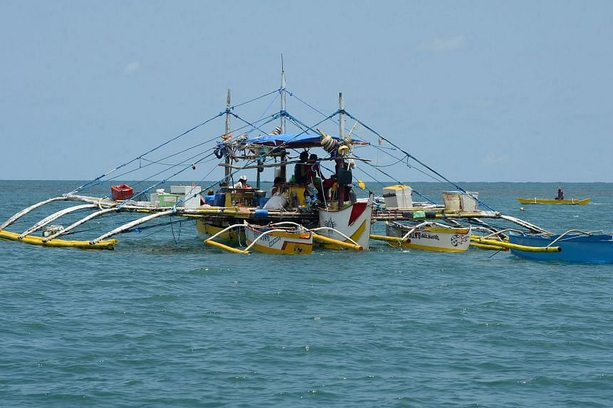 A fishing vessel anchored at the mouth of the South China Sea, as they wait for their fishing expedition to Scarborough Shoal.