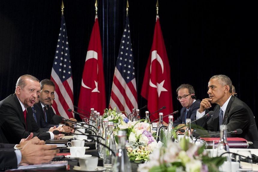 US President Barack Obama (right) and Turkish President Recep Tayyip Erdogan hold a meeting on the sidelines of the G20 Summit in Hangzhou on Sept 4, 2016.