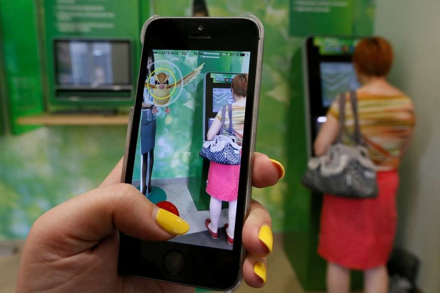 A woman playing the augmented reality mobile game Pokemon Go in Russia on July 20, 2016.