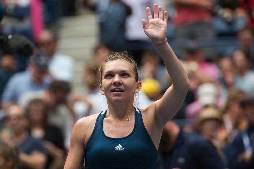 Simona Halep of Romania celebrates her victory over Timea Babos of Hungary.