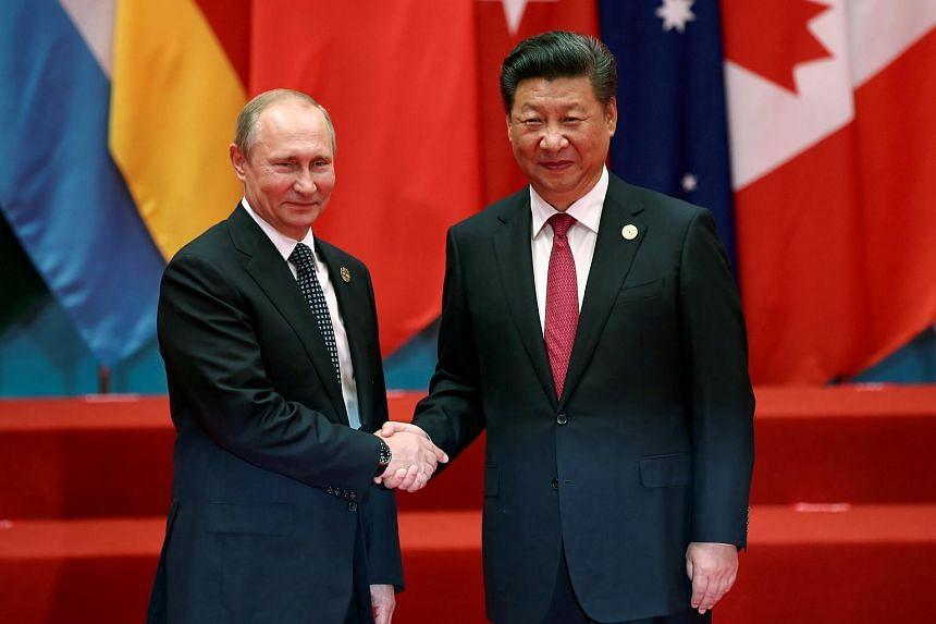 Chinese President Xi Jinping shakes hands with Russian President Vladimir Putin during the G20 Summit in Hangzhou, China on Sept 4, 2016.