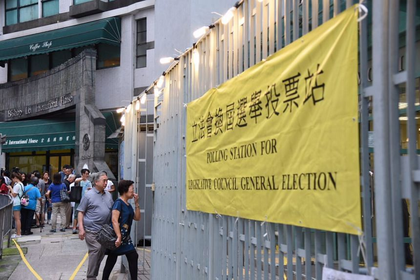 The first few voters going to cast their ballots at a polling station in the Central district.