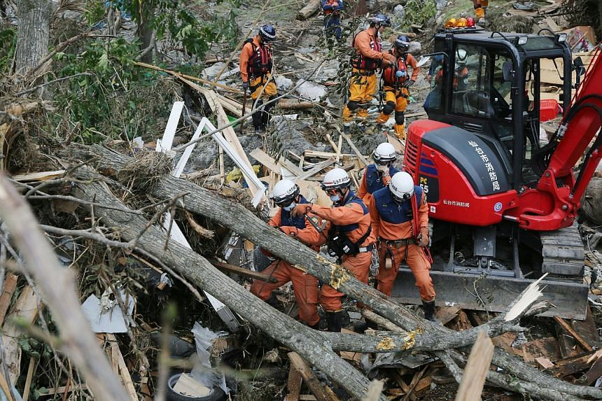 Firefighters searching for victims after Typhoon Lionrock made landfall in Iwaizumi, Iwate prefecture, on Sept 2, 2016.