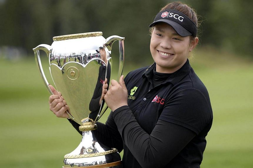 Ariya Jutanugarn of Thailand poses with the championship trophy after winning the Canadian Pacific Women's Open at Priddis Greens Golf and Country Club on Aug 28, 2016.