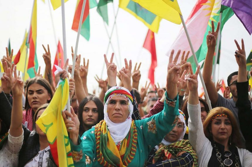Kurds make the victory sign during a demonstration in Cologne, Germany, Sept 3, 2016.