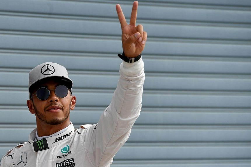 Lewis Hamilton celebrates winning the pole position in the qualifying session at the Autodromo Nazionale circuit in Monza on Sept 3.