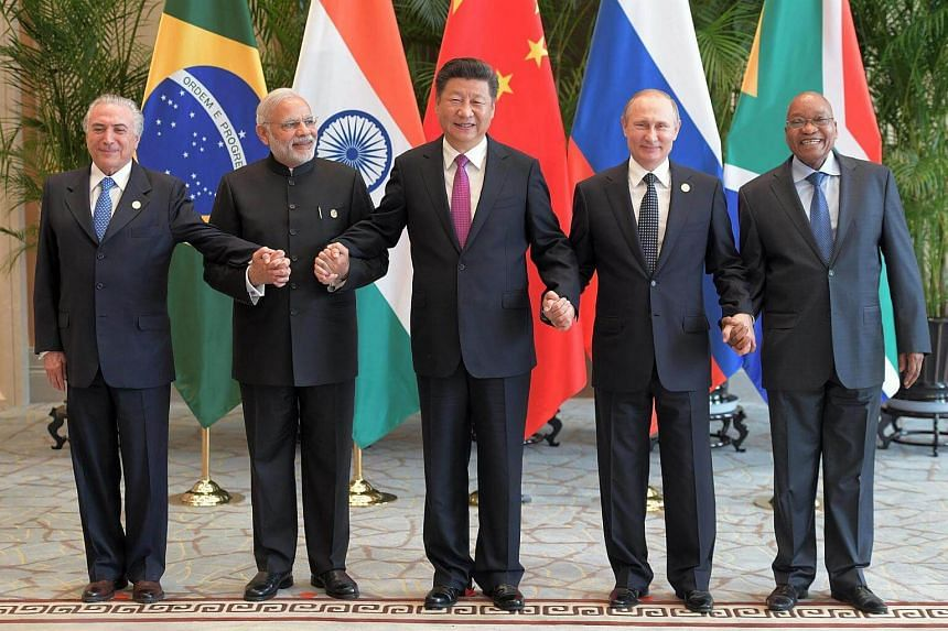 Chinese President Xi Jinping (centre) takes a group photo with (from left) Brazil's President Michel Temer, Indian Prime Minister Narendra Modi, Russian President Vladimir Putin and South Africa's President Jacob Zuma at the West Lake State Guest Hou