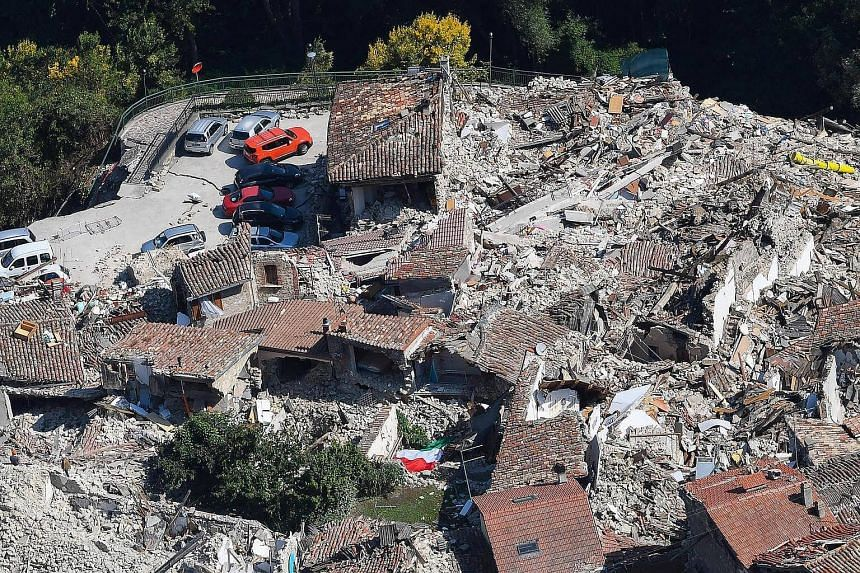 A picture shows an aerial view taken from a Fire Brigades helicopter of buildings damaged by the earthquake in Pescara del Tronto, Italy, Sept 1 2016.