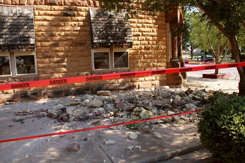 Stonework litters the pavement outside an empty jewellery store in Pawnee, Oklahoma, Sept 3, 2016, after the quake, which was felt in seven states.