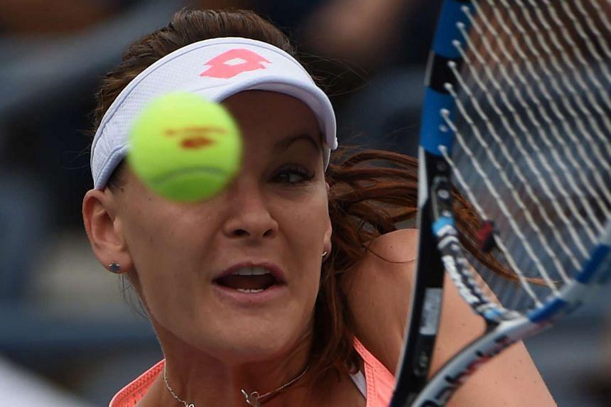 Agnieszka Radwanska of Poland plays against Caroline Garcia of France.