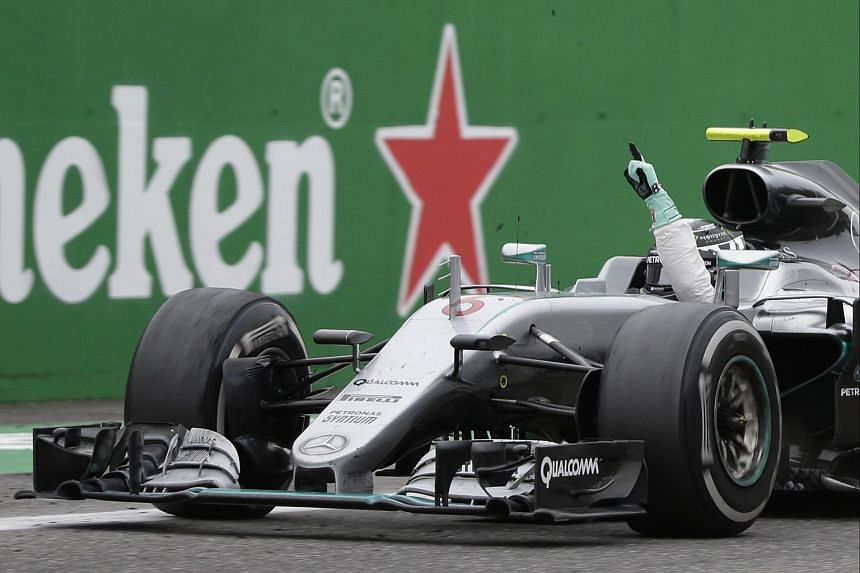 Mercedes' Nico Rosberg crosses the line to win the Italian Grand Prix on Sept 4, 2016.