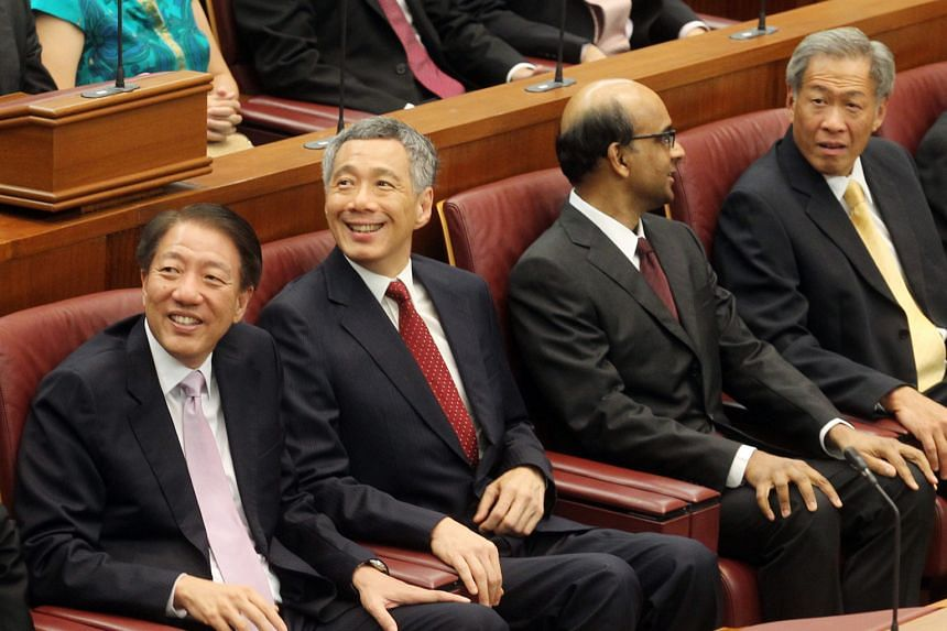 Prime Minister Lee Hsien Loong, flanked by his two Deputy Prime Ministers Teo Chee Hean and Tharman Shanmugaratnam as well as Defence Minister Ng Eng Hen, attending a Parliament session in October 2011.