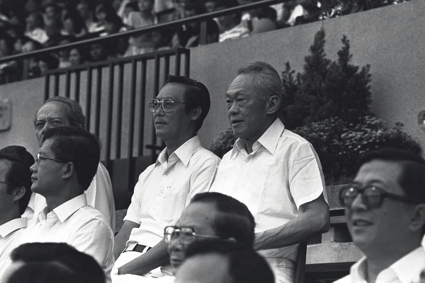 Singapore's first Prime Minister Lee Kuan Yew watching the National Day Parade with then Deputy Prime Minister Goh Chok Tong, Law Minister E. W. Barker and their PAP colleagues at the National Stadium in 1985.