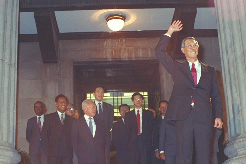 Newly sworn-in Prime Minister Goh Chok Tong greeting the crowd at the Padang after the ceremony at City Hall in 1990, with Senior Minister Lee Kuan Yew and other members of the Cabinet behind him.