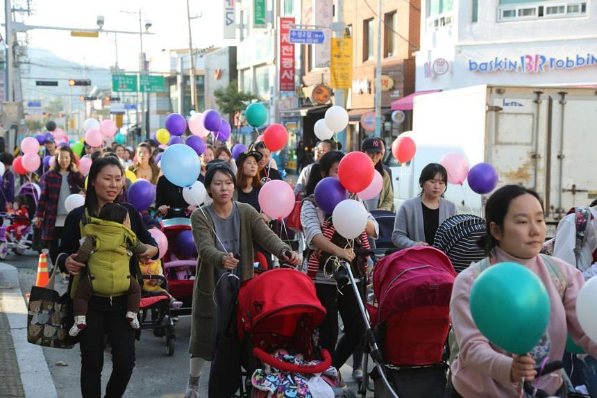 Mothers from Haenam county, at the south-western tip of the Korean Peninsula, celebrating the county's fertility rate of 2.4, almost double the national average. A total of 438,400 babies were born in South Korea last year, which translates to a fert