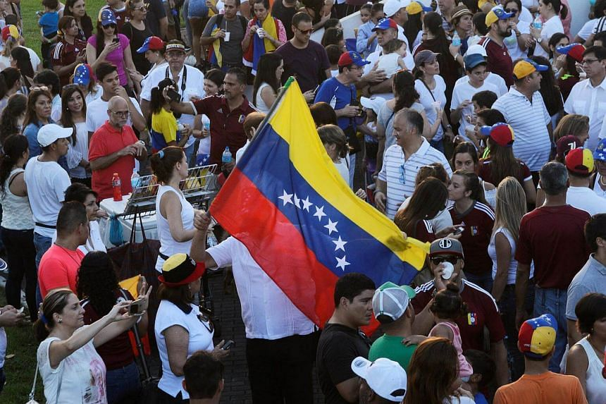 Venezuelans living in Panama take part in a protest to demand a referendum to remove Venezuela's President Nicolas Maduro, in Panama City.