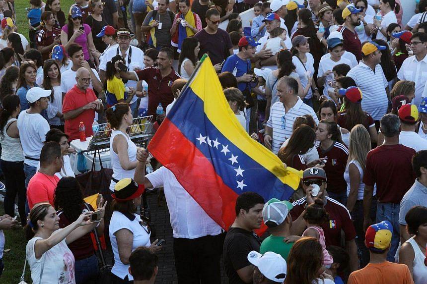 Venezuelans living in Panama take part in a protest to demand a referendum to remove Venezuela's President Nicolas Maduro, in Panama City.