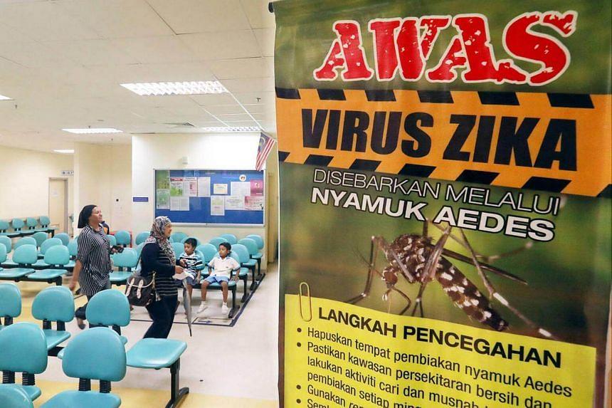 A poster warning of the Zika virus is seen at Hospital Sungai Buloh in Selangor, Malaysia.