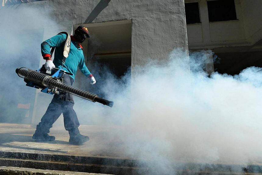Thermal fogging near 55 Sims Drive on Sept 4. MOH is reviewing the practice of isolating potential Zika-infected patients.