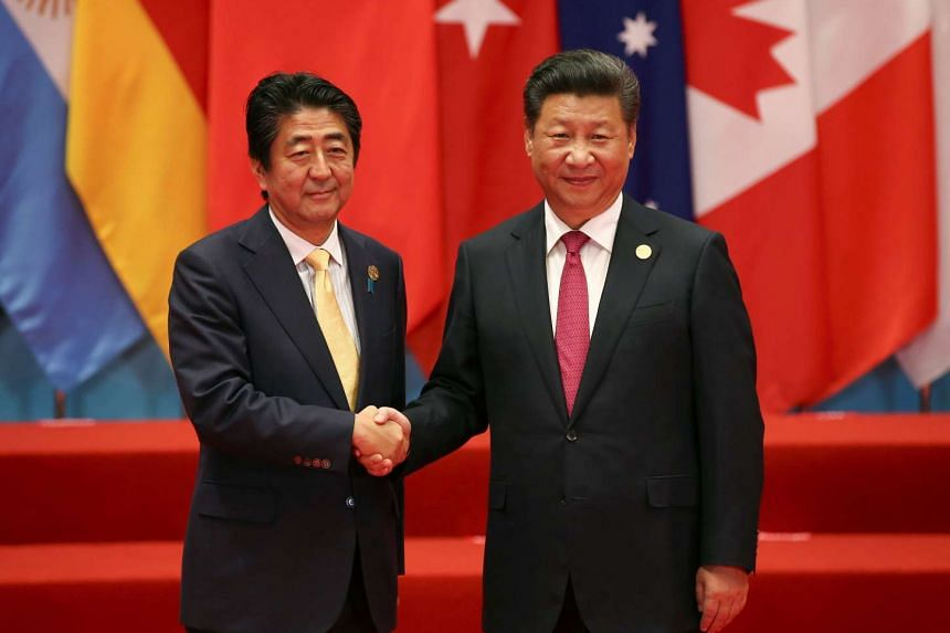 Chinese President Xi Jinping welcomes Japanese Prime Minister Shinzo Abe to the G20 Summit in Hangzhou, China on Sept 4, 2016.