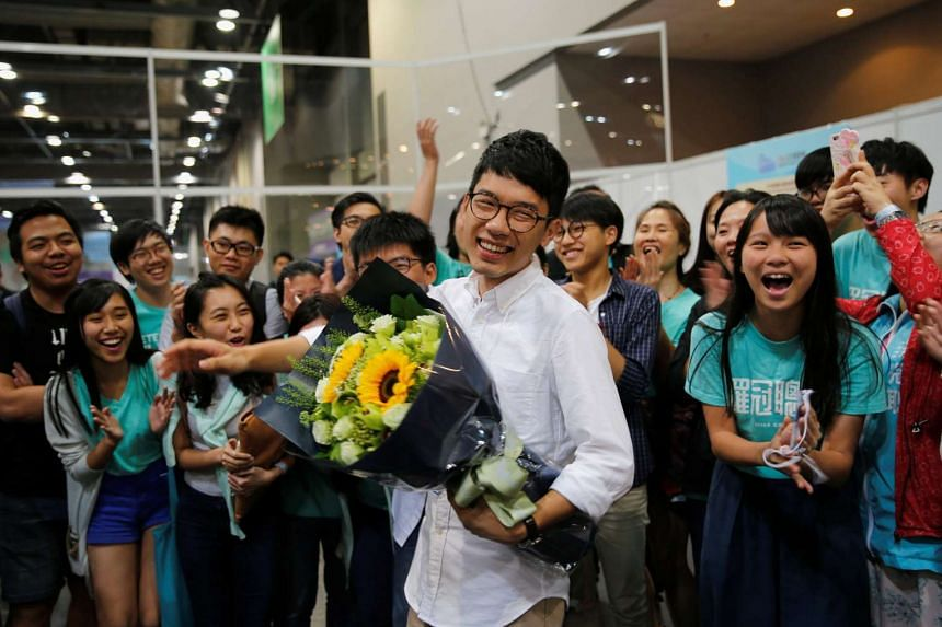 Mr Nathan Law (centre) celebrates after winning a seat in the Legislative Council election in Hong Kong on Sept 5, 2016.