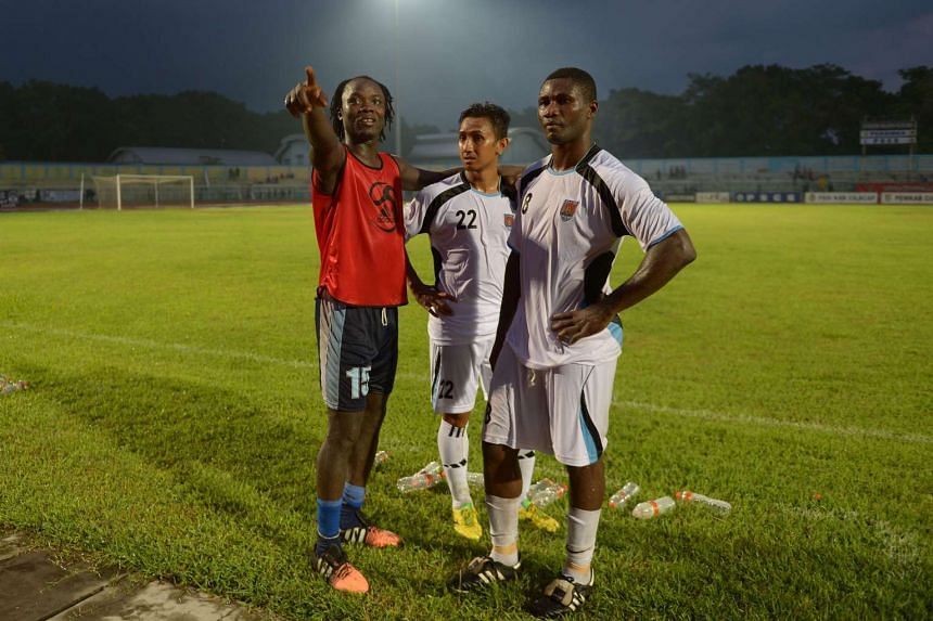 Two foreign players Cameroonian Emile Mbamba (right) and Camaro (left) participating in a football competition in Cilacap, Java on Jan 23, 2016.