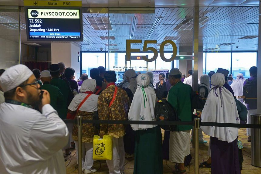 Two groups of Haj pilgrims were sent off by Dr Yaacob Ibrahim at Changi Airport on Sept 5, 2016.