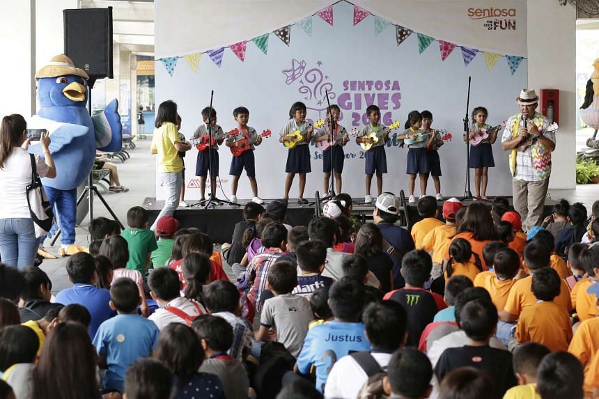 Children from voluntary welfare organisation performing songs on the ukulele for their peers at the Beach Station in Sentosa on Sept 5, 2016.