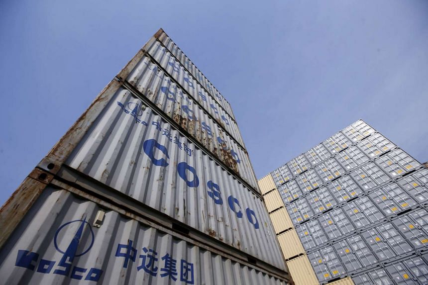 Containers from China Ocean Shipping Company (COSCO) are pictured at a port in Shanghai, China on Feb 17, 2016.