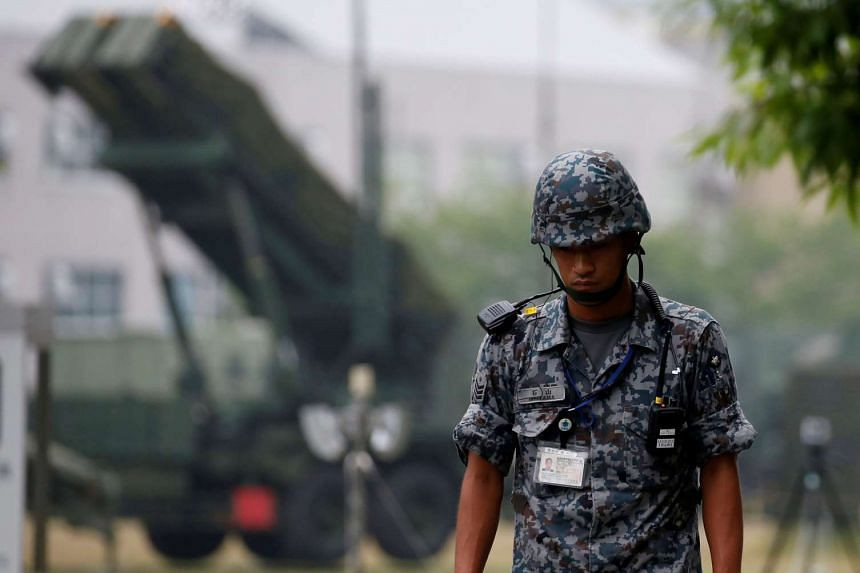 A Japan Self-Defense Forces soldier guards a unit of Patriot Advanced Capability-3 (PAC-3) missiles at the Defense Ministry in Tokyo, Japan on June 22, 2016.