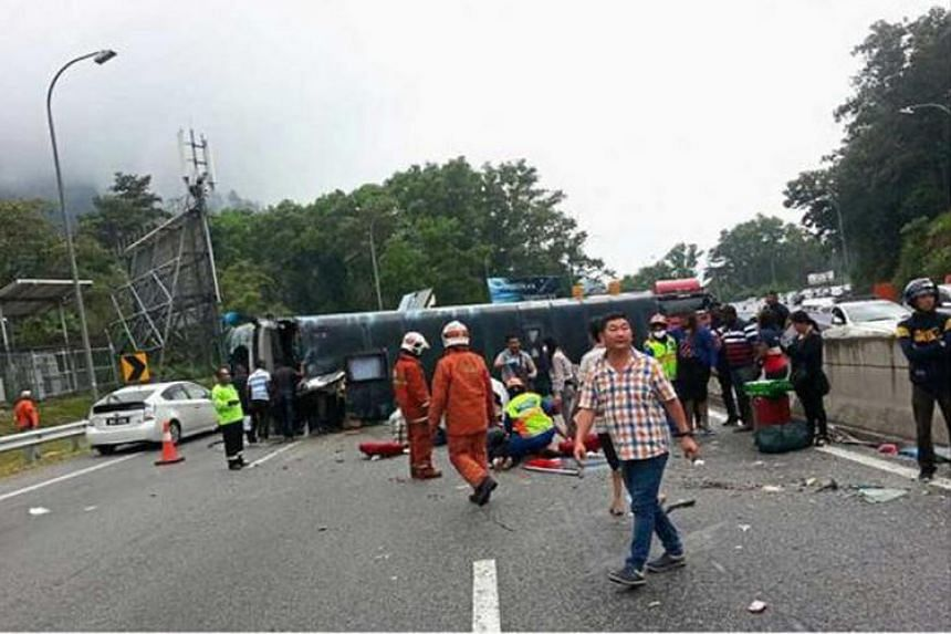 A Singapore tour bus from Grassland Express & Tours overturned on the Karak-KL highway while returning from Genting Highlands on Aug 31, 2016.