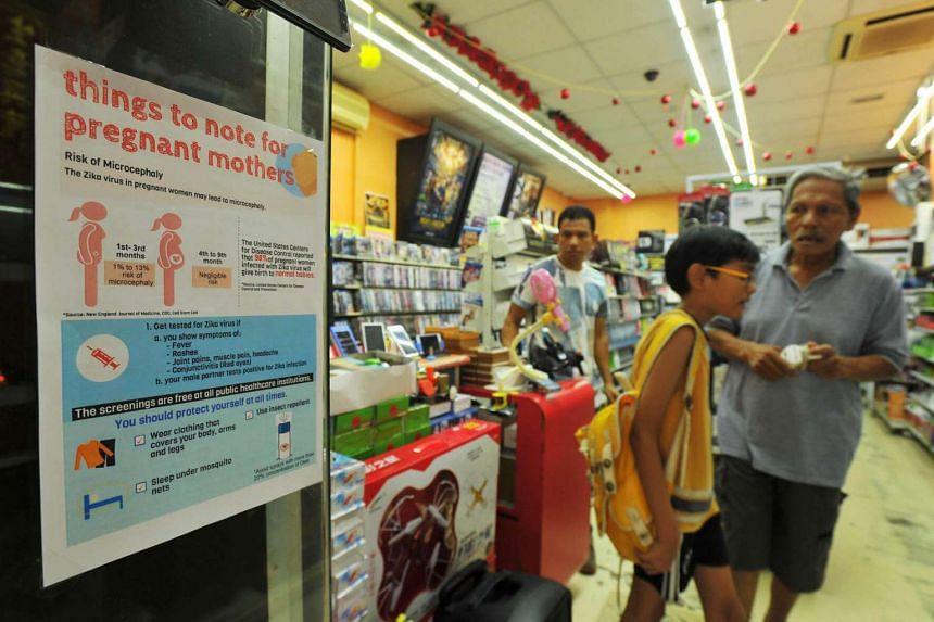 A shop at Pasir Ris West Plaza displays a notice about the Zika virus.