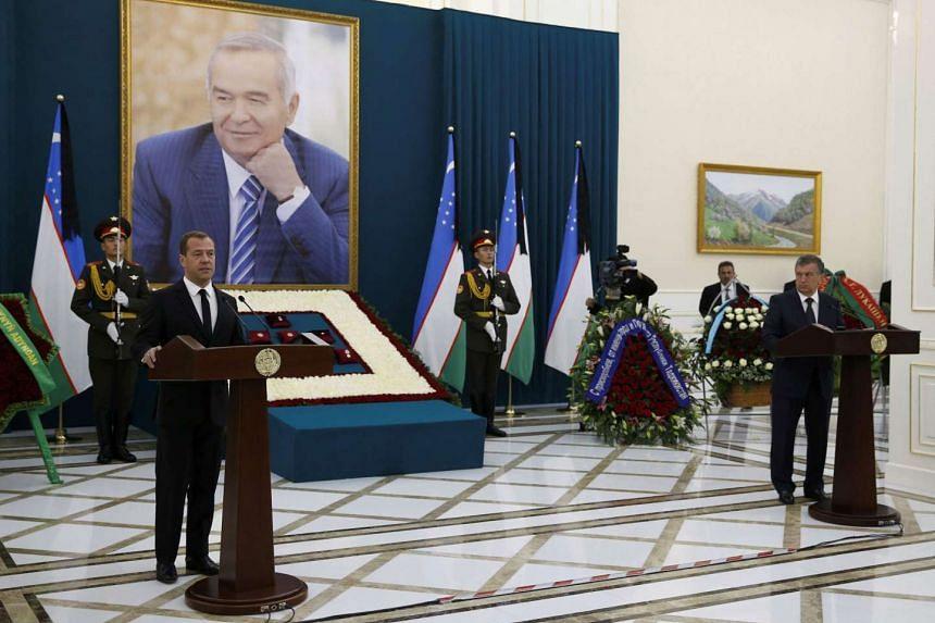 Russian Prime Minister Dmitry Medvedev (Left) delivers a speech during a memorial service before the funeral of Uzbek President Islam Karimov on Sept 3.